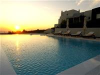 Heated pool in the sunset. There is also a Jacuzzi..