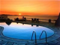 Outdoor pool with sunset view