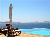 Communal outdoor pool with breathtaking view of the Aegean