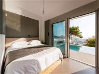 Sunny bedroom next to the pool